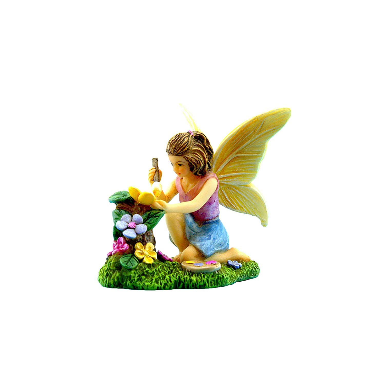 Fairy painting flowers