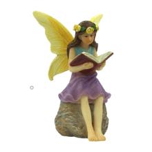 Fairy reading a book