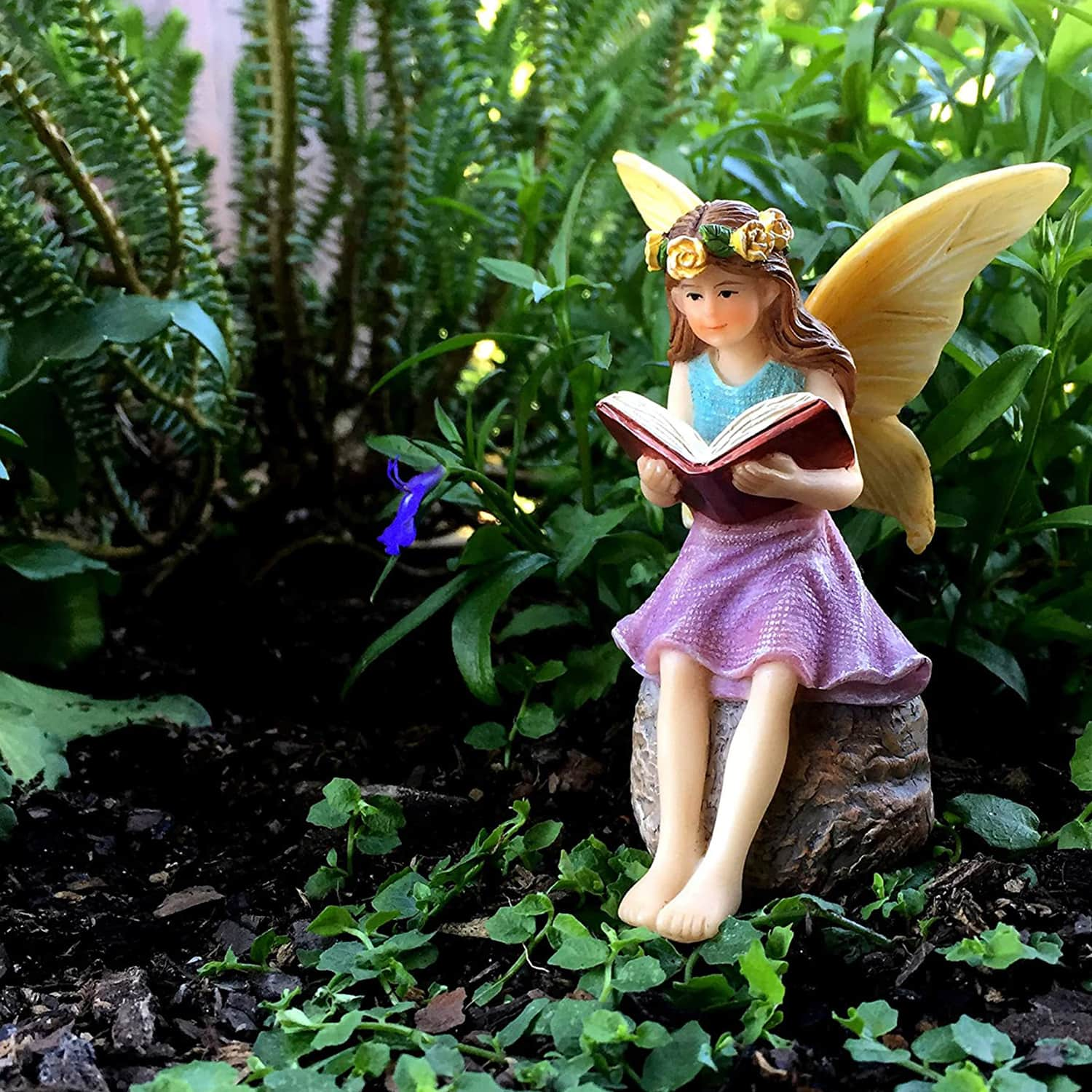 forest fairy reading a book